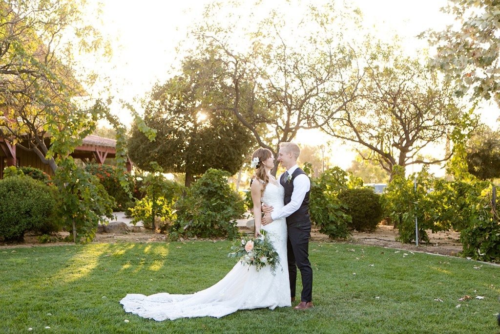 Wedding dress by Danelle's Bridal Boutique | Photo by Leah Marie Photography // Irena & Colby's California winery wedding