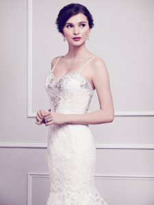 The Mallory Gown has a sweetheart neckline with embellishments on the bodice.