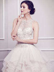 The Diamond gown at Danelle's Bridal Boutique is a white ballgown with a richly embellished bodice and illusion neckline.