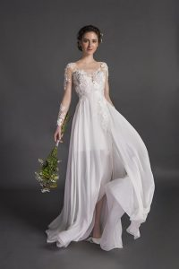 The Piper gown from Danelle's Bridal Boutique is a long sleeve lace wedding gown with a flowy skirt.