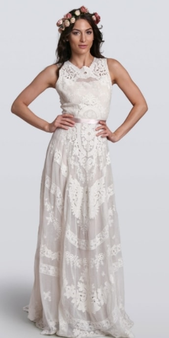 db90e5a9f689 White boho wedding gown with crochet and lace. Model wears gown with a red  and ...