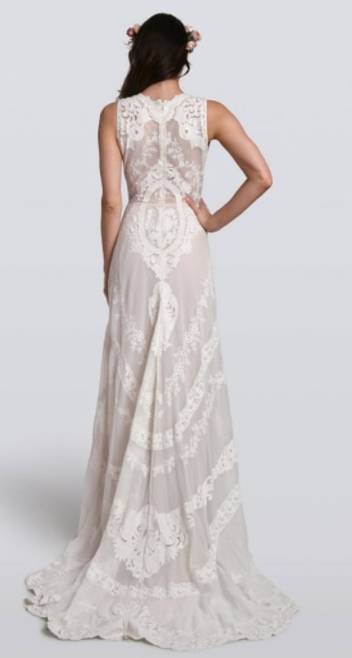 80c3a7e38085 ... White boho wedding gown with crochet and lace. Model wears gown with a red  and ...