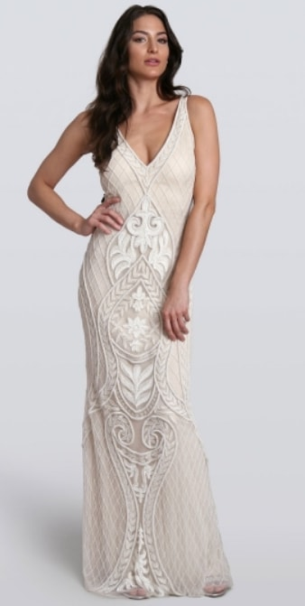 9daa11283904 ... White boho wedding gown with crochet and lace. Model wears gown with a red  and