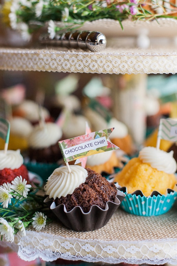 Mini cake tower with colorful cupcake wrappers & floral labels for a vintage DIY wedding in Woodland Park, Colorado. Photo by Rachel Havel