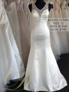 Alexis Wedding Dress size 12 Danelle's Bridal Outlet in Pueblo, Colorado. Satin fit and flare bridal gown with beaded embellishments on straps and neckline.