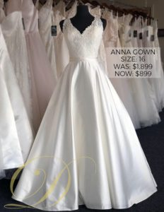 Anna Gown Size 16 at Danelle's Bridal Outlet in Pueblo, Colorado. Now only $899 marked down from $1,899 original price at Colorado's premier bridal outlet. Ivory lace bodice with tank straps and full satin ball gown skirt.