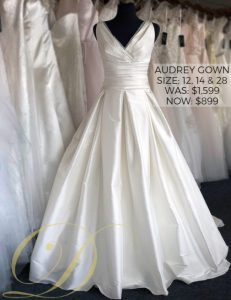 Audrey Wedding Gown size 12, 14, 28 at Danelle's Bridal Outlet in Pueblo, Colorado. A satin ball gown with tank straps and ruched bodice. Now only $899 at outlet sale price; marked down from $1,599 original price.