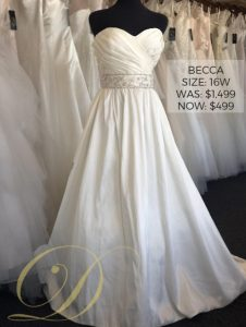 Becca Wedding Dress size 16 W at Danelle's Bridal Outlet in Pueblo, Colorado. A strapless sweetheart a-line bridal gown with built-in bra structure; attached bridal belt. Now only $499 at outlet sale price, was $1,499 original price.