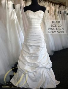 Blair Wedding Gown size 20 at Danelle's Bridal Outlet, Colorado's premier bridal outlet. Now only $799 at outlet sale price, marked down from $1,399 original price. A ruched satin strapless sweetheart drop waist ballgown with dreamy layered fabric and beaded embellishments at neckline.