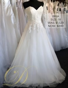 Bria Wedding Dress size 18 at Danelle's Bridal Outlet in Pueblo, Colorado. A gorgeous sweetheart neckline ball gown with unique lace pattern on bodice, and full tulle skirt. Now only $899 at outlet sale price, marked down from $1,329 original price at Colorado's premier bridal outlet.