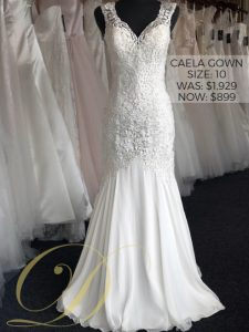 Caela Wedding Dress size 10 at Danelle's Bridal Outlet in Pueblo, Colorado. A luxe privately designed fit and flare bridal gown with intricate embellished embroidery; ivory chiffon skirt. Now only $899 at outlet sale price, marked down from $1,929 original price.