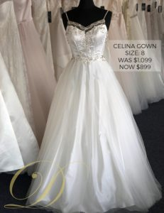 Celina Wedding Gown size 8 at Danelle's Bridal Outlet in Pueblo, Colorado. A satin ballgown with beaded embellishments on bodice, spaghetti straps, and tulle overlay skirt. Now only $899 at outlet sale price, marked down from $1,099 original price.