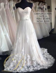 Dahlia Wedding Dress size 8 at Danelle's Bridal Outlet in Pueblo, Colorado. Now just $899 at outlet sale price, marked down from $1,989 original price. A strapless sweetheart neckline a-line bridal gown with floral detailing on English netting overlay skirt.