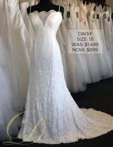 Daisy Wedding Dress size 18 at Danelle's Bridal Outlet in Pueblo, Colorado. Now just $899 on sale, marked down from $1,499 original price. An allover lace sheath gown with elegant train and lace detailing at neckline.