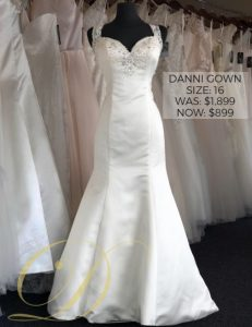 Danni Wedding Dress size 16 at Danelle's Bridal Outlet in Pueblo, Colorado. A satin fit and flare gown with a sweetheart neckline and beaded embellishments on bodice & straps.