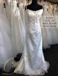 Eden Wedding Dress at Danelle's Bridal Outlet in Pueblo, Colorado. Size 24 richly embellished bridal gown in satin with delicate embroidered overlay. Original price $1,499 now on sale for just $899.