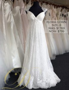 Flora Wedding Dress at Danelle's Bridal Outlet in Pueblo, Colorado. A size 8 empire waist allover lace wedding gown with delicate lace cap sleeves for a vintage touch. Now only $799 on sale, marked down from $1,769 original price.