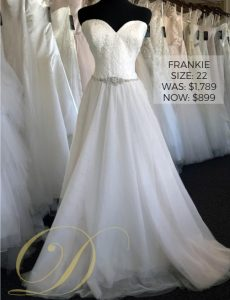 Frankie Wedding Dress size 22 at Danelle's Bridal Outlet in Pueblo, Colorado. Strapless sweetheart neckline lace bodice with bridal belt attached, and flowy chiffon a-line skirt. Original price $1,789 marked down to $899 on sale.