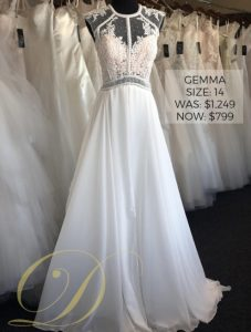 Gemma Wedding Dress size 14 at Danelle's Bridal Outlet in Pueblo, Colorado. Fit and flare bridal gown with cap sleeves and illusion neckline. Original price $1,249 now only $799 on sale.