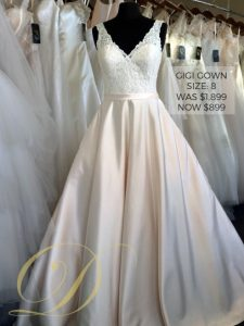 Gigi Wedding Dress size 8 at Danelle's Bridal Outlet in Pueblo, Colorado. Bridal ball gown with ivory lace bodice and blush satin full skirt. Now only $899, marked down from $1,899.