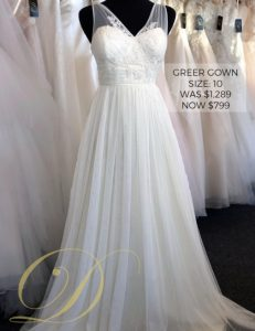 Greer Wedding Dress at Danelle's Bridal Outlet in Pueblo, Colorado. A chiffon tank v-neck bridal gown with delicate lace embroidery at bodice. Shown in a size 10, now just $799 marked down from $1,289.