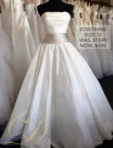 Josephine Wedding Dress Size 12 at Danelle's Bridal Outlet in Pueblo, Colorado. Strapless satin ballgown with two-tone ruched bodice. Now only $499 marked down from original price of $1,599.