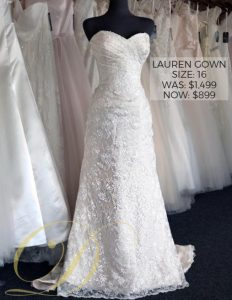 Lauren Wedding Gown at Danelle's Bridal Outlet in Pueblo, Colorado. Size 16 strapless sweetheart bridal gown with allover lace and ruched bodice. Original price $1,499 now $899.