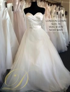 London Wedding Dress at Danelle's Bridal Outlet in Pueblo, Colorado. Size 16 ball gown with satin ruched bodice and strapless sweetheart neckline. Full tulle skirt in ivory. Original price $1,679 now on sale for $899.