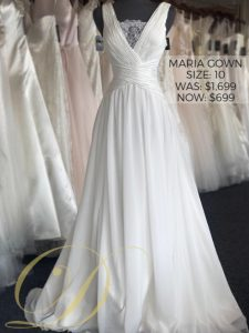 Maria Wedding Dress at Danelle's Bridal Outlet in Pueblo, Colorado. A breezy boho chiffon wedding gown with lace detailing at the bust. Ruched wide straps and wrap around waistline. Now on sale for only $699.