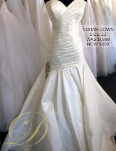 Norah Wedding Gown at Danelle's Bridal Outlet in Pueblo, Colorado. Size 22 Satin ballgown with ruched bodice and embellished detail at hip. Now on sale for only $899.