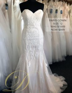 Paris Wedding Gown at Danelle's Bridal Outlet in Pueblo, Colorado. Size 12 strapless sweetheart bridal gown with blush lining and embellishments throughout bodice. Delicate floral and sparkle detail. Marked down to $899 from original price of $1,689.
