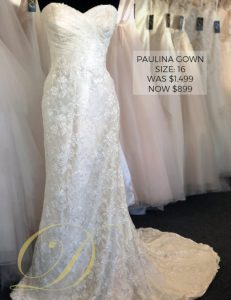 Paulina Wedding Dress at Danelle's Bridal Outlet in Pueblo, Colorado. Bridal gown on sale for only $899. Size 16 sweetheart neckline strapless gown with ruched bodice and detailed floral lace pattern.