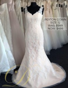 Peyton Wedding Gown only $499 on sale at Danelle's Bridal Outlet in Pueblo, Colorado. Size 12 lace overlay fitted gown with blush lining.