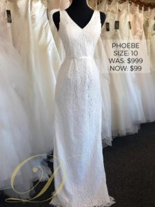 Phoebe Wedding Dress at Danelle's Bridal Outlet in Pueblo, Colorado. Bridal gown on sale from $999 original price to $99. Size 10 allover lace sheath wedding gown with v-neck and tank straps. Satin ribbon at waist.