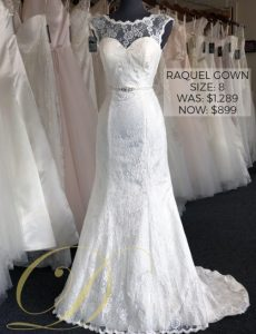 Raquel Wedding Dress at Danelle's Bridal Outlet in Pueblo, Colorado. Size 8 lace overlay wedding gown with illusion neckline and bridal belt attached at the waist.
