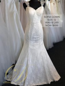 Sofia Wedding Dress at Danelle's Bridal Outlet in Pueblo, Colorado. Size 12 allover lace wedding gown with sweetheart neckline, lace cap sleeves, and fitted trumpet silhouette.