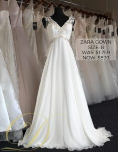 Zara Wedding Gown at Danelle's Bridal Outlet in Pueblo, Colorado. Beaded sleeveless v-neck wedding gown size 8 with flowy chiffon skirt.